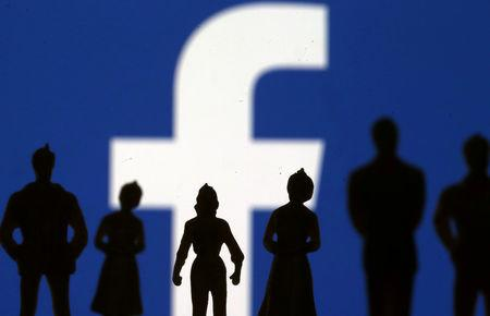 FILE PHOTO: Small toy figures are seen in front of Facebook logo in this illustration picture, April 8, 2019. REUTERS/Dado Ruvic/File Photo