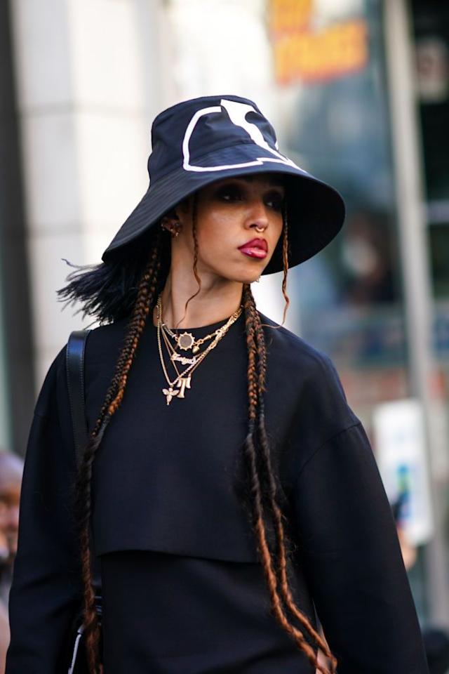 """<p>In recent years, <a href=""""https://www.crfashionbook.com/fashion/a21967443/history-of-bucket-hat-fashion/"""" target=""""_blank"""">bucket hats</a> have become the equalizing accessory, elevating street style and bringing a wearable edge to the runway. Although the unisex style was widely popularized by hip-hop artists in the 1980s, bucket hats give a decidedly '90s flair to headwear as they entered mainstream fashion and pop culture during the noughties. Since designers such as Michael Kors and Chanel began reintroducing the trend for Spring/Summer 2018, they have consistently appeared on catwalks during the following seasons, most recently in the Off-White and Fendi Spring/Summer 2020 men's collections. The style has also become a favorite among models like Bella Hadid, musicians such as FKA Twigs, and a bevy of other celebrities, proving that the bucket hat is here to stay. </p>"""