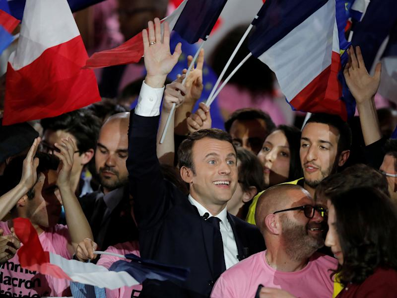 Emmanuel Macron attending a campaign rally in Paris, where his rival Marine Le Pen was also attempting to drum up support: Reuters