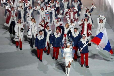 FILE PHOTO: Russia's flag-bearer Alexander Zubkov leads his country's contingent during the athletes' parade at the opening ceremony of the 2014 Sochi Winter Olympics, February 7, 2014. REUTERS/Lucy Nicholson/File Photo