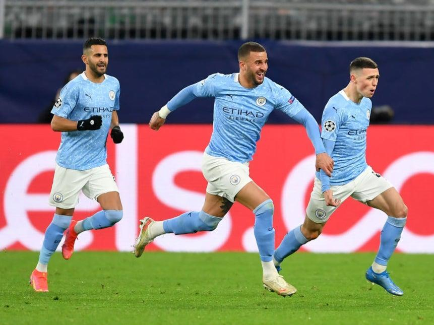 Riyad Mahrez, Kyle Walker and Phil Foden celebrateGetty Images