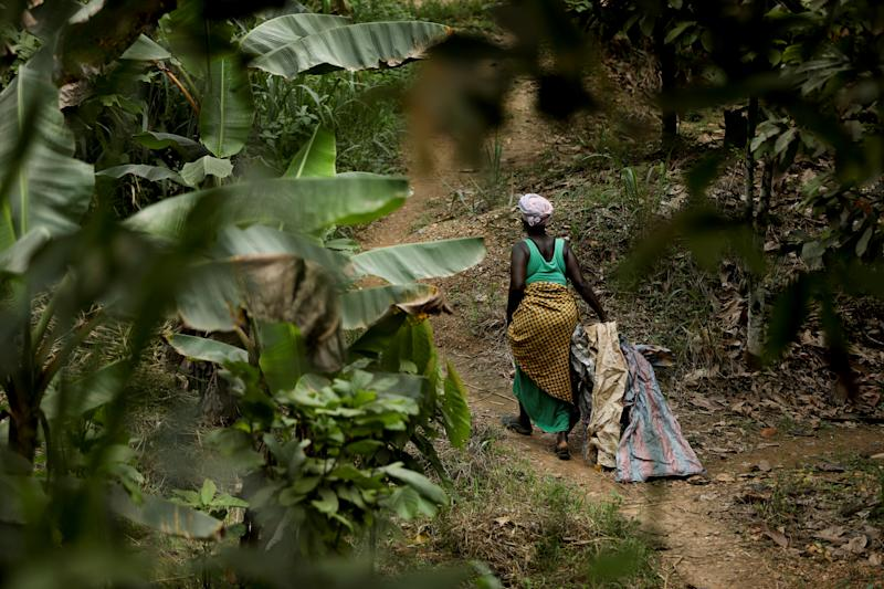 A woman walks trough the bushes in Prestea, a mining town in southwest Ghana. (Photo: Siphiwe Sibeko/Reuters)