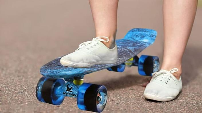 Get your wheels rolling with this penny board.