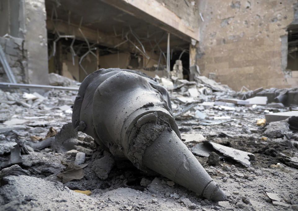 A rocket front fragment lies at a newly built natal center damaged by shelling by Azerbaijan's artillery in Stepanakert, the separatist region of Nagorno-Karabakh, Wednesday, Oct. 28, 2020. Nagorno-Karabakh officials said Azerbaijani forces hit Stepanakert, the region's capital, and the nearby town of Shushi with the Smerch long-range multiple rocket systems, killing one civilian and wounding two more. (AP Photo)
