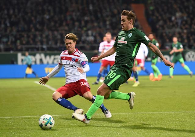 Soccer Football - Bundesliga - Werder Bremen vs Hamburger SV - Weser-Stadion, Bremen, Germany - February 24, 2018 Hamburg's Gotoku Sakai in action with Werder Bremen's Max Kruse REUTERS/Fabian Bimmer DFL RULES TO LIMIT THE ONLINE USAGE DURING MATCH TIME TO 15 PICTURES PER GAME. IMAGE SEQUENCES TO SIMULATE VIDEO IS NOT ALLOWED AT ANY TIME. FOR FURTHER QUERIES PLEASE CONTACT DFL DIRECTLY AT + 49 69 650050