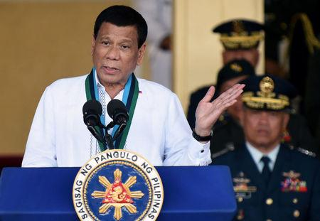 FILE PHOTO: Philippine President Rodrigo Duterte gestures during the change of command ceremony of the Armed Forces of the Philippines (AFP) at Camp Aguinaldo in Quezon City, Metro Manila, Philippines April 18, 2018.   REUTERS/Dondi Tawatao