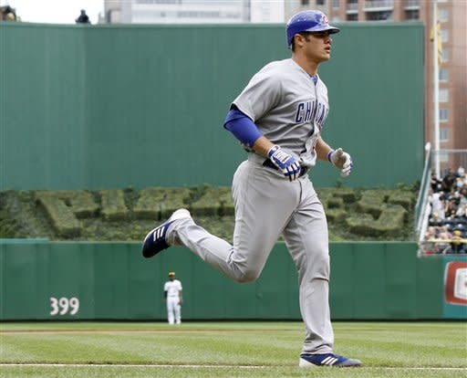 Chicago Cubs' Anthony Recker trots around the bases after hitting the Cubs' second home run of the fourth inning of a baseball game against the Pittsburgh Pirates on Sunday, Sept. 9, 2012, in Pittsburgh. (AP Photo/Keith Srakocic)