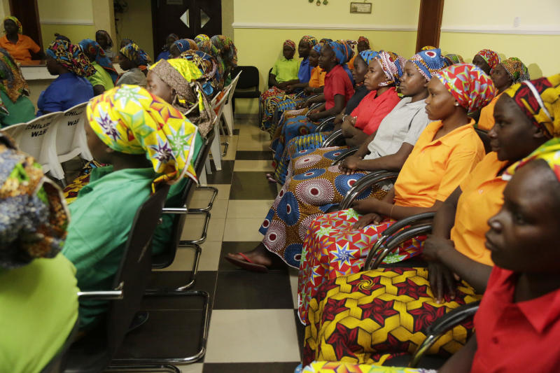 Chibok schoolgirls, recently freed from Nigeria extremist captivity, are photographed in Abuja, Nigeria, Monday May 8, 2017. Nigeria's presidency has released the names of the 82 Chibok schoolgirls newly freed from the Boko Haram extremists. The list was released late Sunday night after Nigerian President Muhammadu Buhari met with the young women before leaving for London for medical checkups as fears for his health continue. (AP Photo/Sunday Alamba)