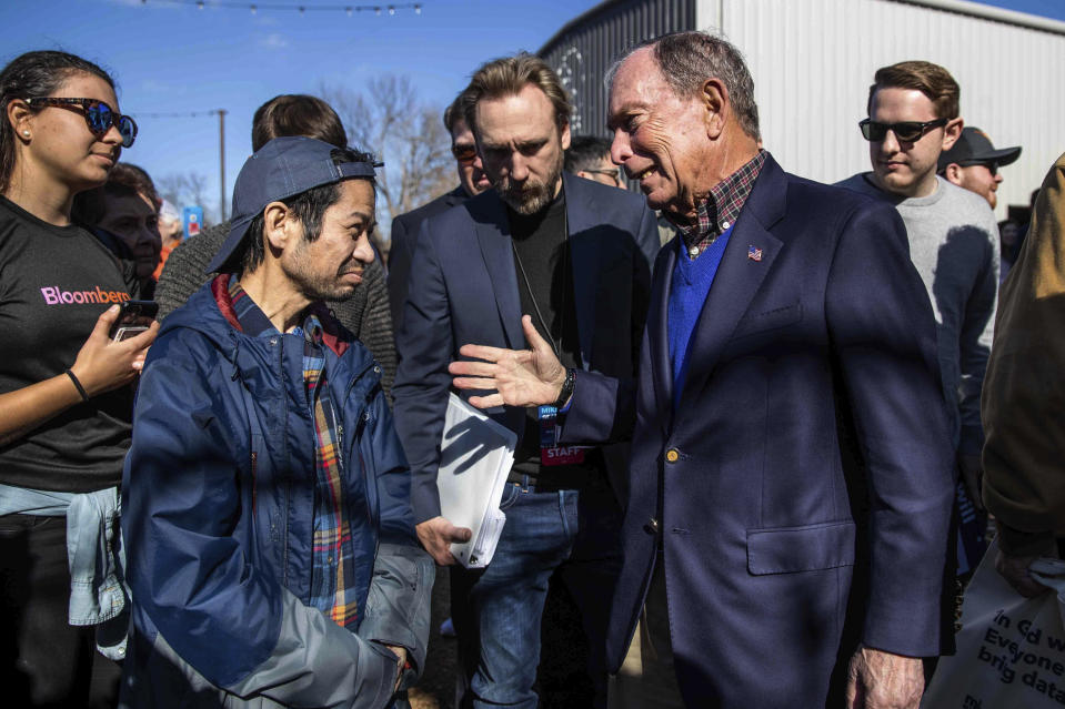 Democratic presidential candidate Michael Bloomberg speaks to David Lee-Sue after his speech during his presidential campaign in Austin, Texas, Saturday, Jan. 11, 2020. (Lola Gomez/Austin American-Statesman via AP)