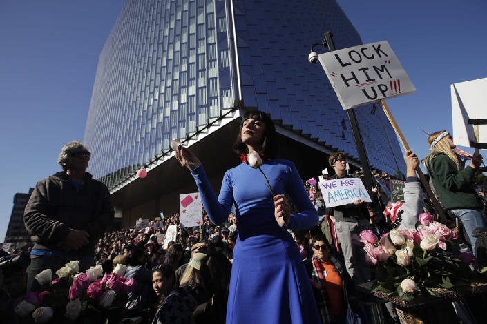 <p>Artist Cocovan, center, performs as thousands of protesters gather for the Women's March against President Donald Trump Saturday, Jan. 21, 2017, in Los Angeles. (AP Photo/Jae C. Hong) </p>