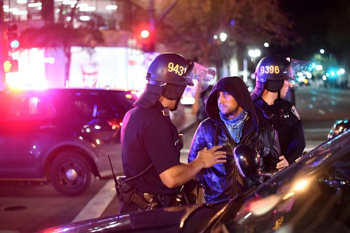 <p>Police detain a protester marching against president-elect Donald Trump in Oakland, Calif., on Nov. 9, 2016. (Photo: Noah Berger/Reuters) </p>