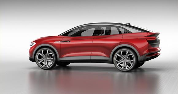 The Volkswagen I.D. Crozz II Concept, a red crossover SUV with a curved roof.