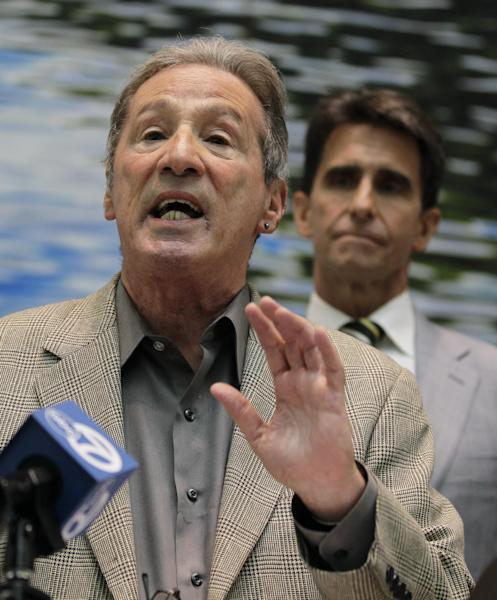 """In this Wednesday, Oct. 19, 2011 file photo,, State Assemblyman Tom Ammiano, left, gestures as State Senator Mark Leno, right, looks on during a news conference calling for the end of Federal attacks on medical marijuana dispensaries in San Francisco. Ammiano has said he was """"frustrated"""" by Obama's recent comments, saying the federal government needs to stop shuttering dispensaries in states with medical marijuana laws, including California. """"A good step here would be to stop raiding those legal dispensaries who are doing what they are allowed to do by law"""". (AP Photo/Eric Risberg, File)"""