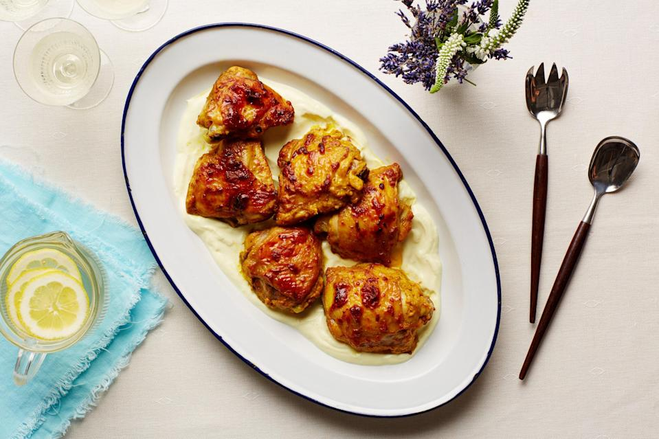 """Yogurt gets used in two ways in this simple chicken dish: as a tenderizing marinade and mixed with the pan juices to create a rich sauce for serving. <a href=""""https://www.epicurious.com/recipes/food/views/garlic-curry-chicken-thighs-with-yogurt-sauce-56389736?mbid=synd_yahoo_rss"""" rel=""""nofollow noopener"""" target=""""_blank"""" data-ylk=""""slk:See recipe."""" class=""""link rapid-noclick-resp"""">See recipe.</a>"""