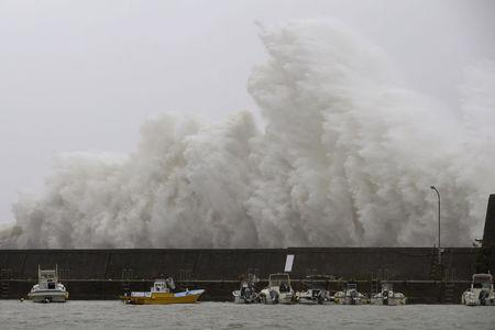 Wave caused by Typhoon Noru crashes on a breakwater in Aki