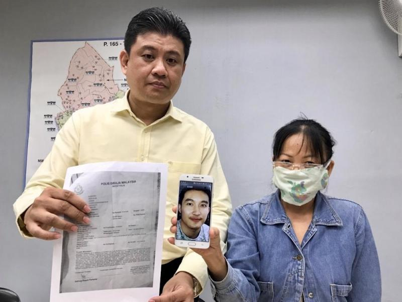 Stulang assemblyman Andrew Chen Kah Eng (left) with the victim identified only as Mrs Lee during the press conference held at the former's service centre in Taman Maju Jaya in Johor Baru December 10, 2019. — Picture by Ben Tan