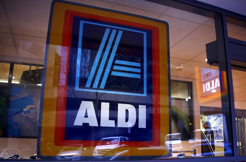 A customer walks into the German discount supermarket ALDI in Sydney, Australia June 19, 2015. Fresh fruit and vegetables are the new frontline in ALDI Inc's assault on Australia's $70 billion supermarket sector, as the German discounter looks to beat the most profitable duopoly in global groceries at their own game. For the first time, ALDI's Australian arm plans to ship fruit and vegetables direct from farms in Australia to its stores, according to one major fruit supplier, removing the only competitive advantage for incumbent heavyweights Woolworths Ltd and Wesfarmers-owned Coles. REUTERS/David Gray