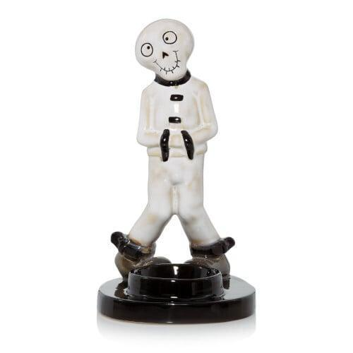 <p>Odd and creepy, this <span>Make 'Em Laugh Tea Light Candle Holder</span> ($20) will add some fun to your decor.</p>
