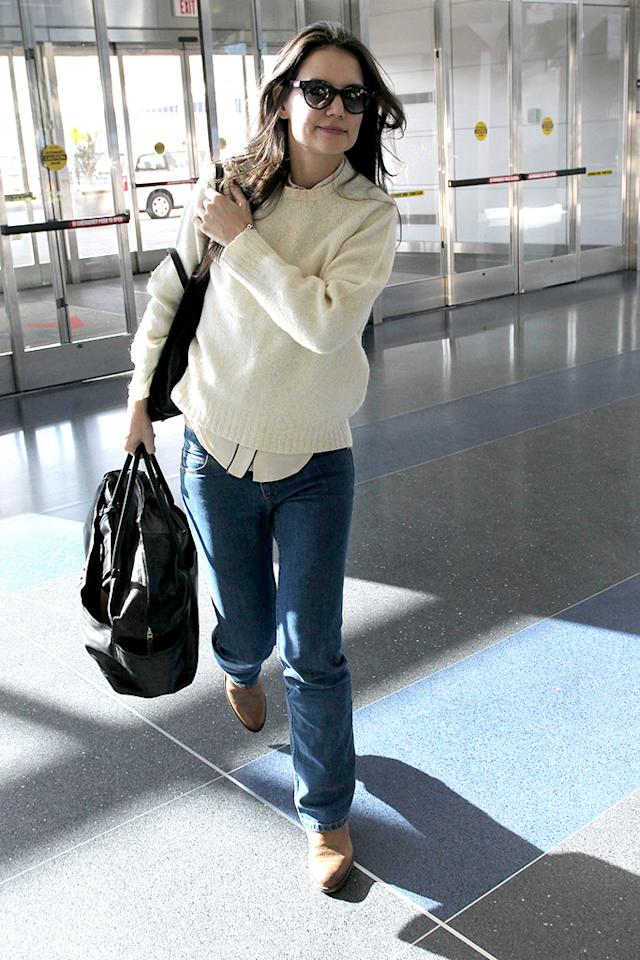 Katie Holmes walking through JFK Airport to catch a flight out of New York City