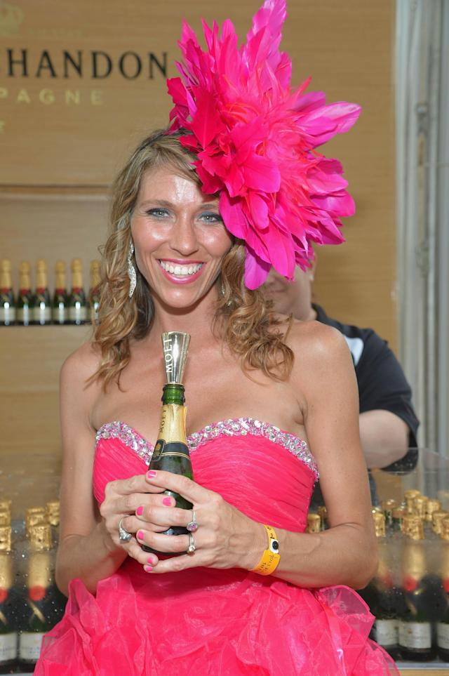 LOUISVILLE, KY - MAY 03: A guest celebrates Kentucky Oaks Day with Moet & Chandon at Churchill Downs on May 3, 2013 in Louisville, Kentucky. (Photo by Mike Coppola/Getty Images for Moet & Chandon)
