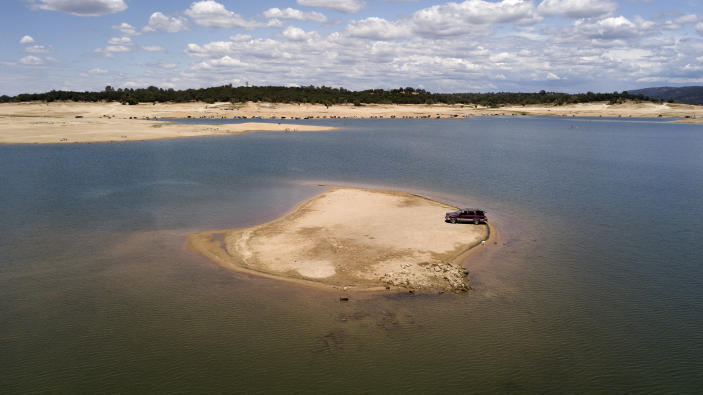 William Heinz parks his vehicle on a newly revealed piece of land due to receding waters at the drought-stricken Folsom Lake in Granite Bay, Calif., Saturday, May 22, 2021. California Gov. Gavin Newsom declared a drought emergency for most of the state. (AP Photo/Josh Edelson)