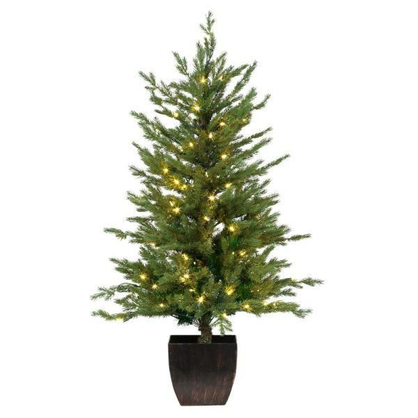 """<p><strong>Home Accents Holiday</strong></p><p>homedepot.com</p><p><strong>$129.00</strong></p><p><a href=""""https://go.redirectingat.com?id=74968X1596630&url=https%3A%2F%2Fwww.homedepot.com%2Fp%2FHome-Accents-Holiday-4-ft-Pre-Lit-Warm-White-LED-Potted-Artificial-Christmas-Tree-Set-of-2-TY017-1717%2F301573283&sref=https%3A%2F%2Fwww.countryliving.com%2Fhome-design%2Fdecorating-ideas%2Fg5027%2Fbest-artificial-christmas-trees%2F"""" rel=""""nofollow noopener"""" target=""""_blank"""" data-ylk=""""slk:Shop Now"""" class=""""link rapid-noclick-resp"""">Shop Now</a></p><p>Standing at four feet tall, this faux Christmas tree will fool a few visitors—thanks in part to its pot!</p>"""