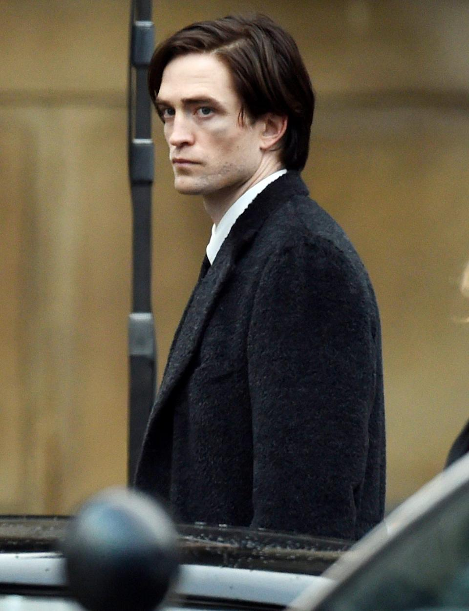 <p>Robert Pattinson is seen in character while filming<i> Batman</i> in Liverpool on Wednesday. </p>