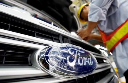 FILE PHOTO: A man works at Ford Vietnam car factory in Hai Duong