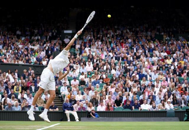 A capacity crowd was allowed into Wimbledon for the first time since the 2019 tournament but second seed Daniil Medvedev suffered a shock quarter-final defeat to Hubert Hurkacz