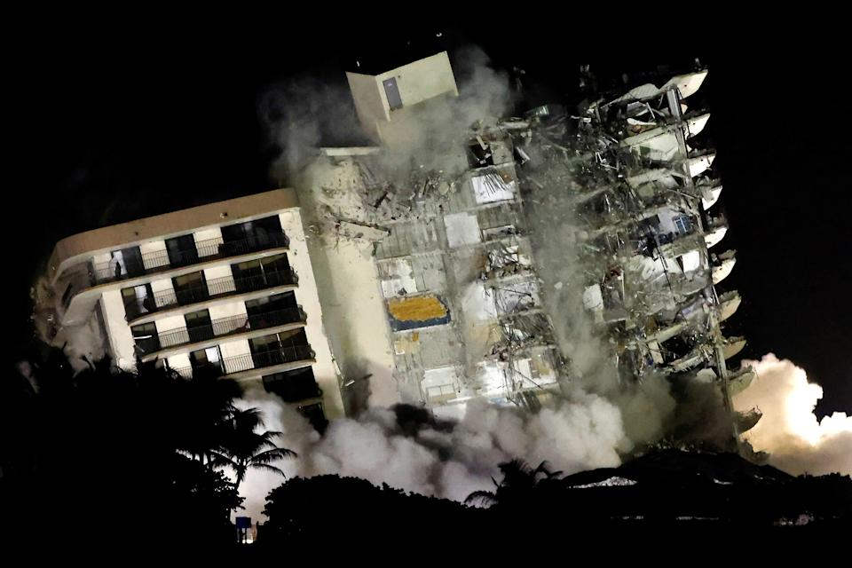 The rest of the partially collapsed condo is demolished Sunday.
