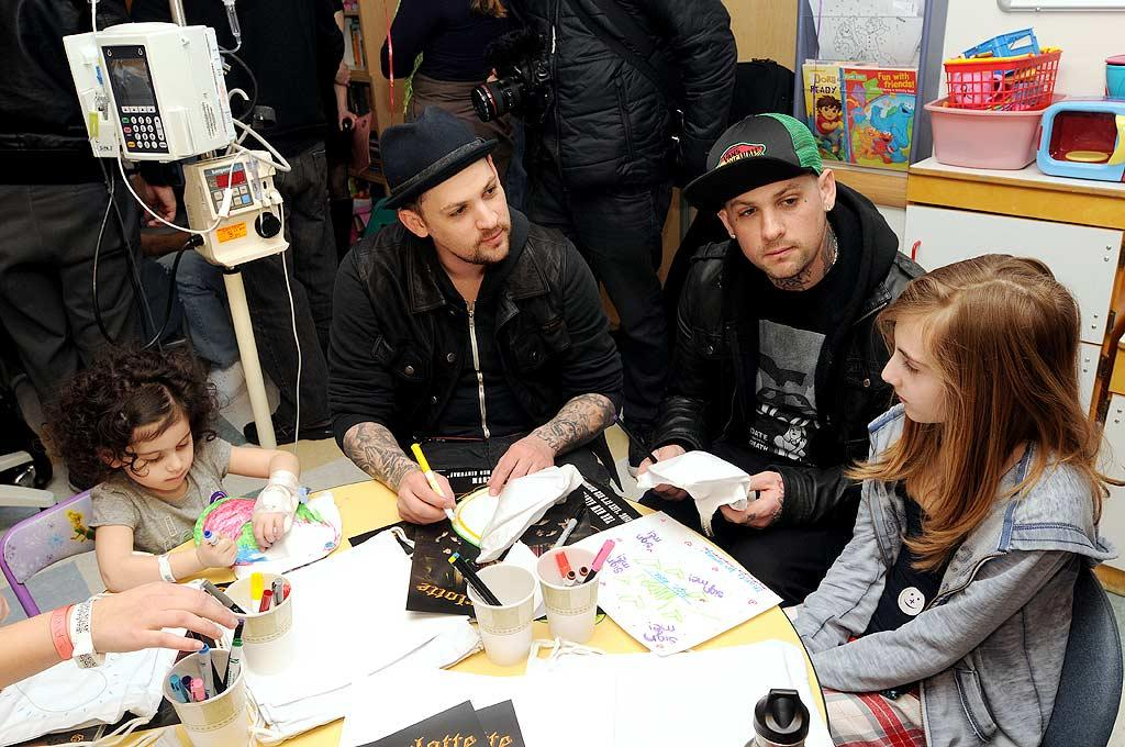 "While they were in town on tour, Good Charlotte's Joel and Benji Madden made time to spread cheer to patients at Children's Hospital in Boston, Massachusetts, on Wednesday. ""A very special shout out to all my friends at Boston Children's Hospital i met today. U kids inspire me! Thanks so much for the smiles!"" tweeted Joel after their visit. Darren McCollester/<a href=""http://www.wireimage.com"" target=""new"">WireImage.com</a> - March 9, 2011"