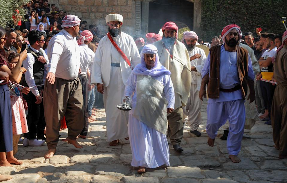 Iraqi Yazidis take part in a religious ceremony at the Temple of Lalish, in a valley near the Kurdish city of Dohuk, in 2019. (Safin Hamed/AFP via Getty Images)