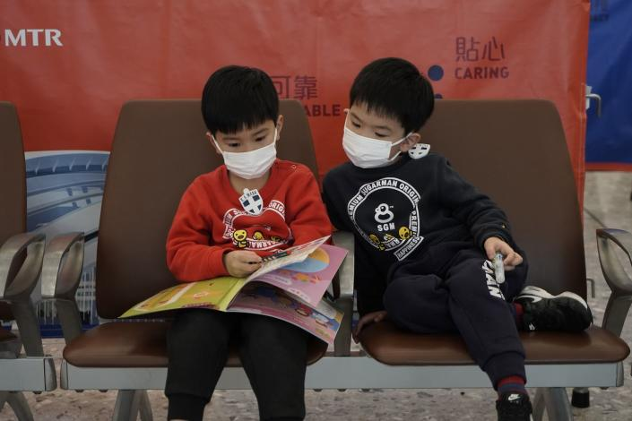 """<span class=""""caption"""">Young passengers wear masks on a high-speed train in Hong Kong, Wednesday, Jan. 22, 2020. At that time, it was hard to know how dangerous the virus would be. (AP Photo/Kin Cheung)</span> <span class=""""attribution""""><a class=""""link rapid-noclick-resp"""" href=""""http://www.apimages.com/metadata/Index/APTOPIX-Hong-Kong-China-Outbreak/5e7ce789e8224e29a159f2cf884ac258/165/0"""" rel=""""nofollow noopener"""" target=""""_blank"""" data-ylk=""""slk:AP Photo/Kin Cheung"""">AP Photo/Kin Cheung</a></span>"""