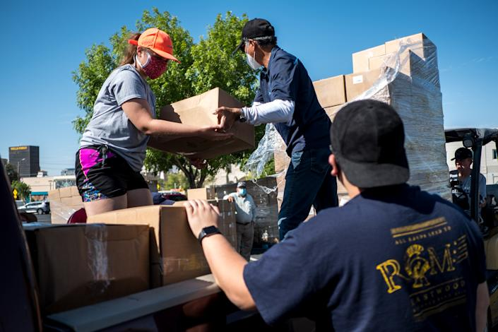 El Paso Baptist Association volunteers hand out boxes of food to church representatives in El Paso, Texas, U.S., on Friday, July, 17, 2020. (Photographer: Joel Angel Juarez/Bloomberg via Getty Images)