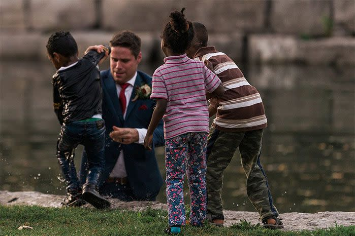 Clayton Cook had little concern for his suit when he jumped into the river to save the young boy. Source: Hatt Photography