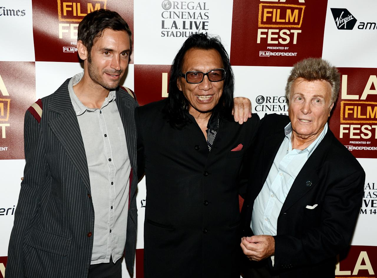 """LOS ANGELES, CA - JUNE 19:  (L-R) Director/writer Malik Bendjelloul, musician Rodriguez and music producer Steve Rowland arrive at the premiere of Sony Pictures Classics' """"Searching For Sugarman"""" at the Los Angeles Film Festival at L.A Live on June 19, 2012 in Los Angeles, California.  (Photo by Kevin Winter/Getty Images)"""