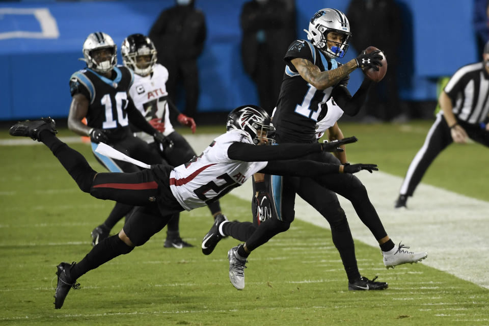 Carolina Panthers wide receiver Robby Anderson is tackled by Atlanta Falcons cornerback Isaiah Oliver during the first half of an NFL football game Thursday, Oct. 29, 2020, in Charlotte, N.C. (AP Photo/Mike McCarn)