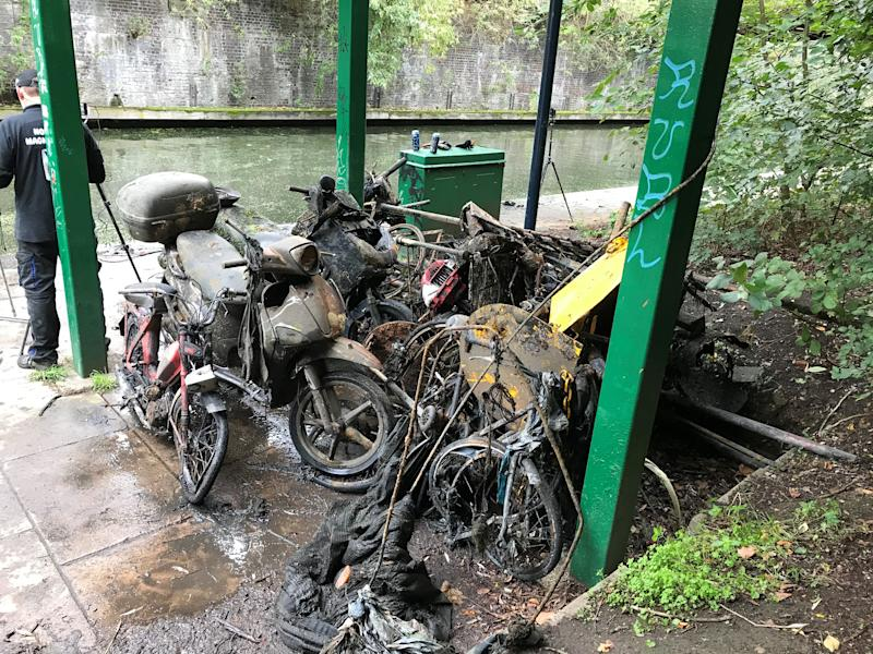Magnet fishers pull shrapnel including three motorbikes, five pushbikes, a penknife and gold jewellery from Regent's Canal in London on Sunday October 11, 2020 (Laura Parnaby/PA).