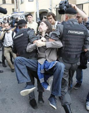 "Police detain a supporter of the female punk band ""Pussy Riot"" for violation of law and order outside a court building in Moscow, August 17, 2012."