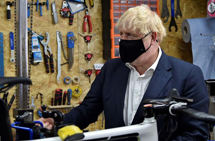 Boris Johnson wears during a visit to a bicycle repair shop in Beeston, central England last week. (Getty)