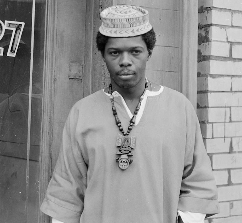 Portrait of Sala Udin (Sam Howze) wearing Anhk necklace and kufi, standing near doorway, Hill District, Pittsburgh, Pa., 1970. (Photo: Charles 'Teenie' Harris/Carnegie Museum of Art/Getty Images)