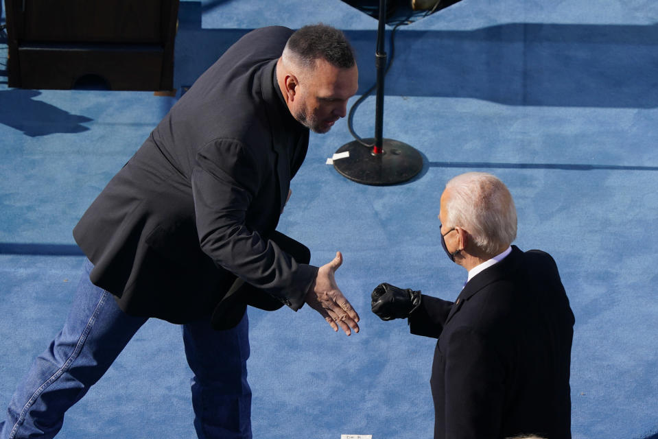 Country singer Garth Brooks reaches out to greet President Joe Biden during the 59th Presidential Inauguration at the U.S. Capitol in Washington, Wednesday, Jan. 20, 2021. (AP Photo/Susan Walsh, Pool)