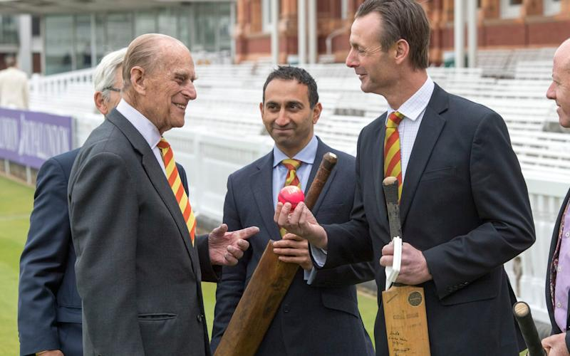 The Duke of Edinburgh (second left) is shown a number of bats by Dr Chinmay Gupte (second right) and John Stephenson (right), during a visit to Lord's cricket ground - Credit: PA