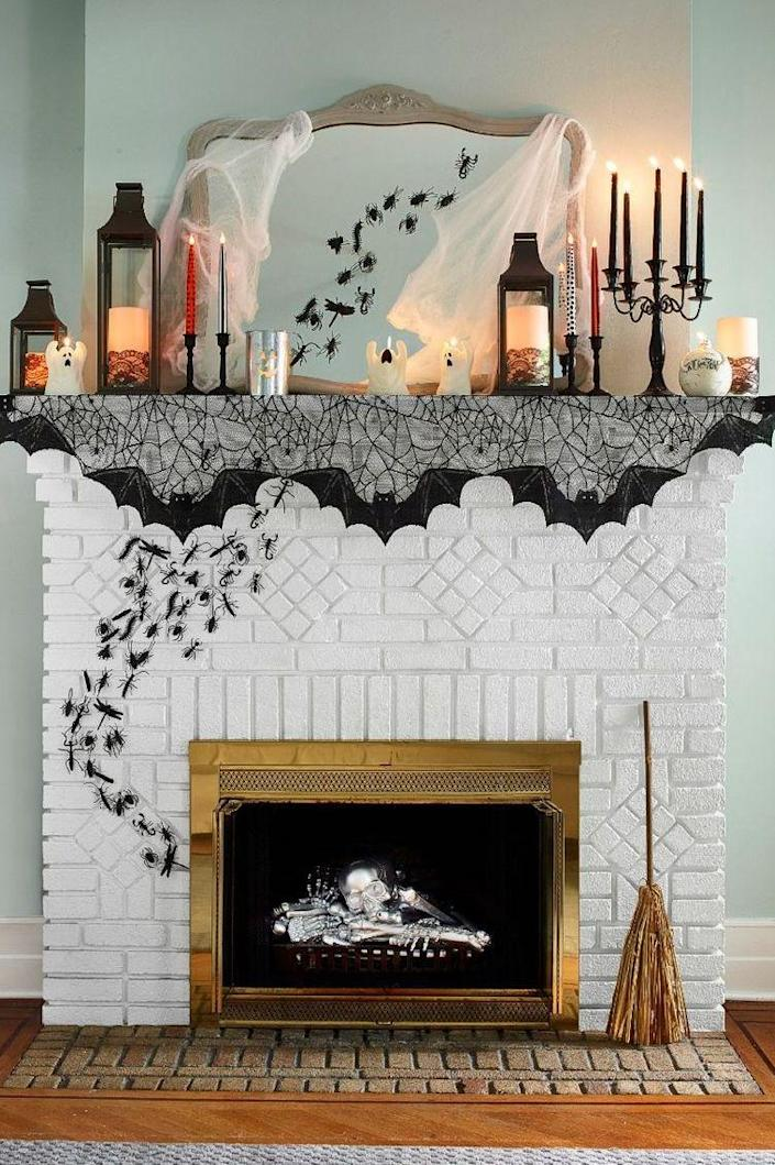 """<p>To get your mantel looking extra morose, you'll want to start with lanterns that hold flameless pillars. Add a candelabra, plus glittery tapers, a grinning votive, ghostly candles, and some fluttery bats. Add some creepy crawlies by spray-painting plastic insects black then arranging in swarm up a wall using glue dots. Bonus points if you add a silver spray-paint pile of bones to your fireplace.</p><p><a class=""""link rapid-noclick-resp"""" href=""""https://www.amazon.com/VINCIGANT-Valentines-Decoration-Candelabra-Centerpieces/dp/B08FX9LMKQ?tag=syn-yahoo-20&ascsubtag=%5Bartid%7C10070.g.1908%5Bsrc%7Cyahoo-us"""" rel=""""nofollow noopener"""" target=""""_blank"""" data-ylk=""""slk:SHOP CANDELABRA"""">SHOP CANDELABRA</a><br></p>"""