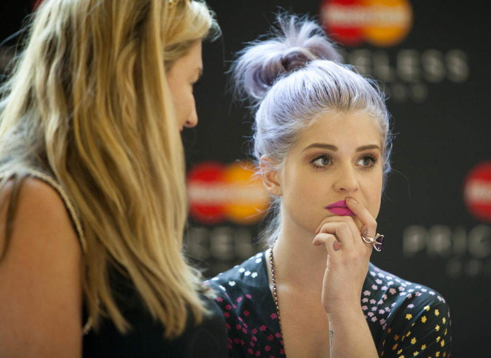 Cable TV star Kelly Osbourne prepares to meet fans at the launch of the Magnificent Mile Shopping Festival on Friday, Aug. 24, 2012 in Chicago. (AP Photo/Sitthixay Ditthavong)
