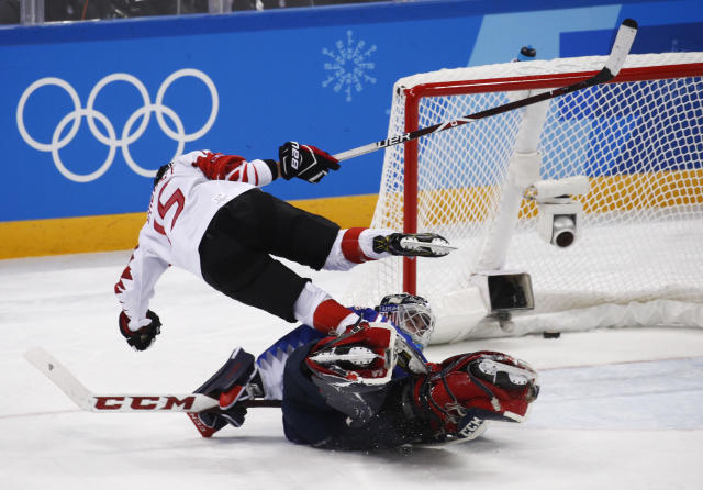 Melodie Daoust (15), of Canada, scores against Goalie Maddie Rooney (35), of the United States, during the shootout in women's gold medal hockey game at the 2018 Winter Olympics in Gangneung, South Korea, Thursday, Feb. 22, 2018. (AP Photo/Jae C. Hong)