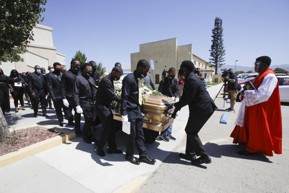 FILE - In this June 30, 2020, file photo, pallbearers carry Robert Fuller's casket after his funeral in Littlerock, Calif. A police investigation confirmed suicide was the cause of death of Fuller, a Black man found hanging from a tree in a Southern California city park last month, authorities said Thursday, July 9, 2020. (AP Photo/Marcio Jose Sanchez, File)