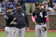 Chicago White Sox manager Tony La Russa, center, stands with Nick Madrigal, left, and Yoan Moncada, right, as he makes a pitching change during the sixth inning of a baseball game against the Kansas City Royals Sunday, May 9, 2021, in Kansas City, Mo. (AP Photo/Charlie Riedel)