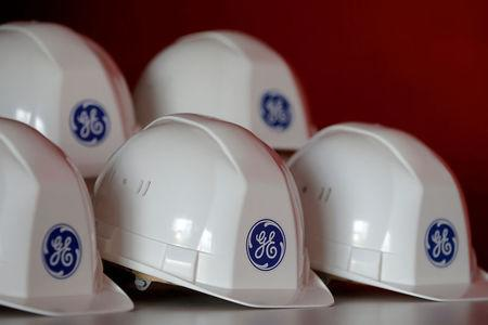 FILE PHOTO: The General Electric logo is pictured on working helmets during a visit at the General Electric offshore wind turbine plant in Montoir-de-Bretagne