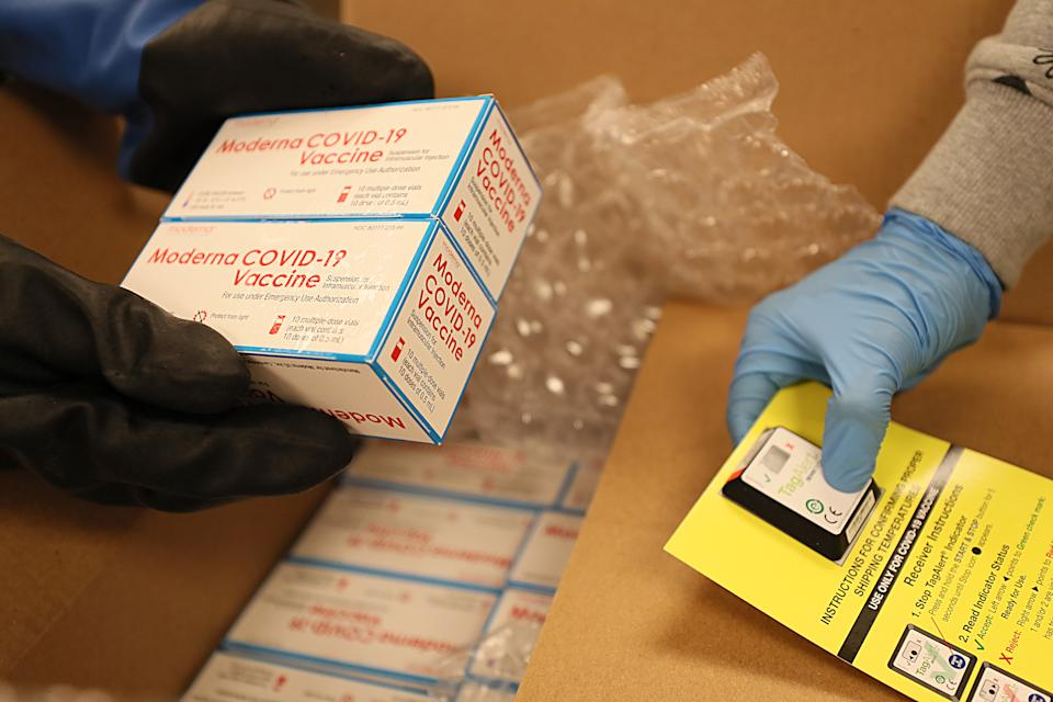 Moderna's COVID-19 vaccine is unpacked in the pharmacy of Boston Medical Center. (Suzanne Kreiter/The Boston Globe via Getty Images)